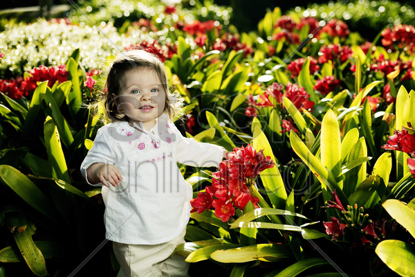 girl posing with beautiful plants stock photo