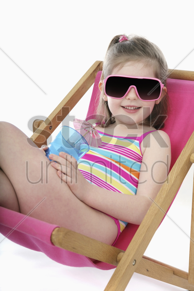 girl relaxing on lounge chair stock photo