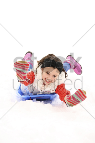 girl riding on the sled stock photo