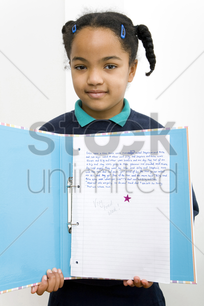 girl showing her good essay stock photo