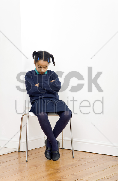 girl sitting on the chair sleeping stock photo