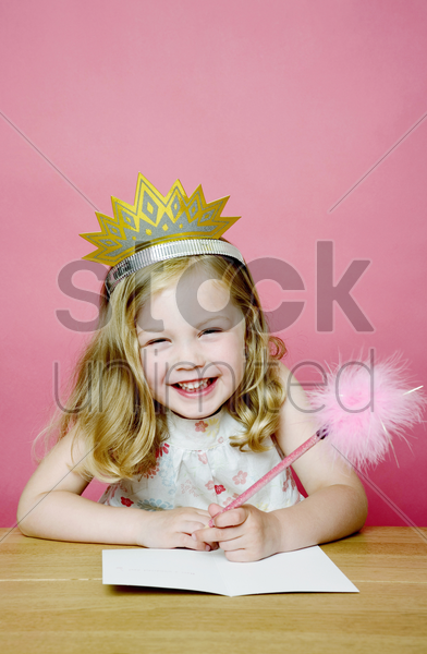 girl smiling while drawing stock photo