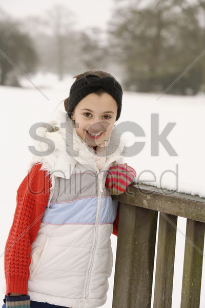 girl taking a break from playing stock photo