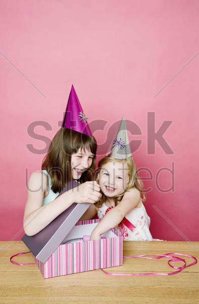 girl taking out her present stock photo