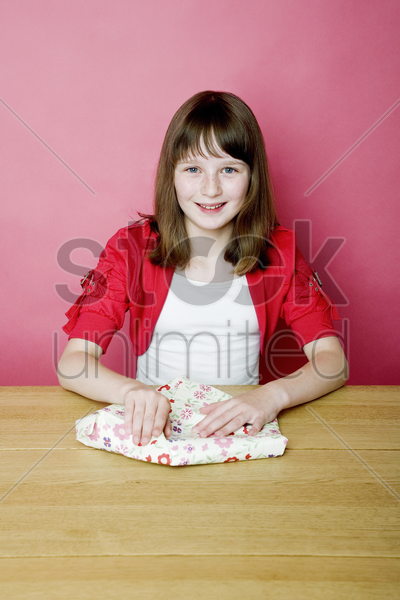 girl unwrapping present stock photo