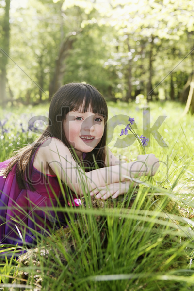 girl with flowers smiling stock photo