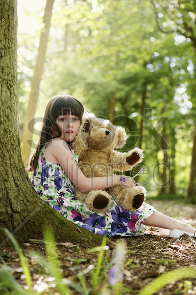 girl with her teddy bear stock photo
