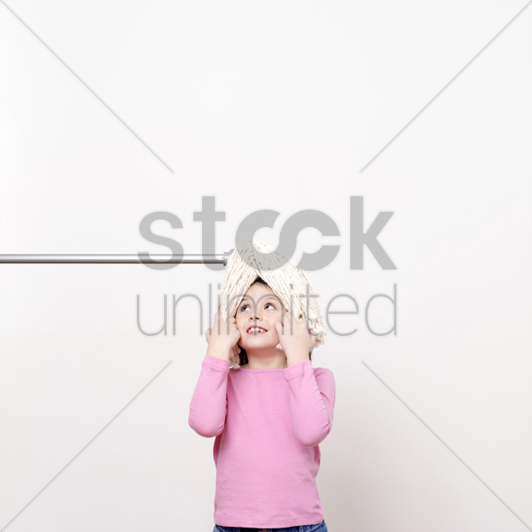 girl with mop on her head stock photo