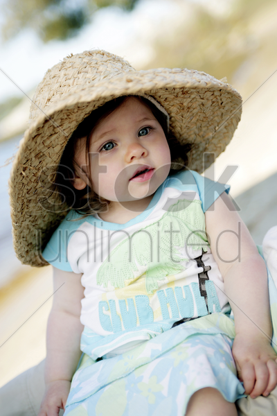 girl with straw hat stock photo