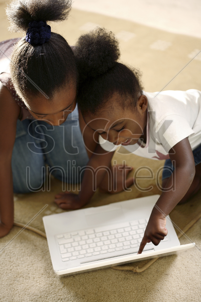 girls using laptop stock photo