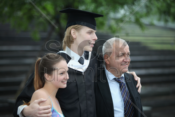 graduate and his family stock photo