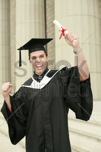 graduate holding up his scroll stock photo