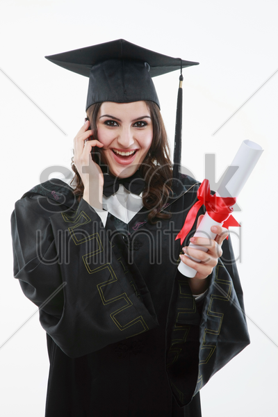 graduate talking on the mobile phone stock photo