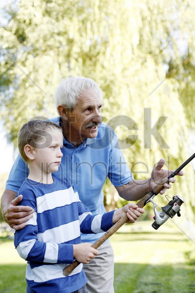 grandfather and grandson fishing together stock photo