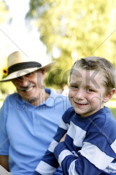 grandfather and grandson having fun in the park stock photo