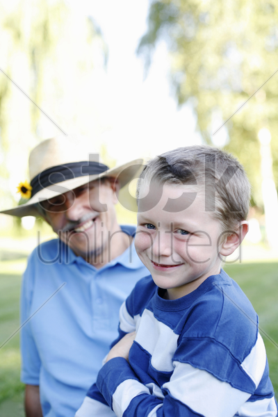 grandfather and grandson in the park stock photo