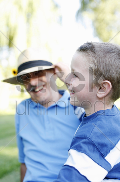grandfather and grandson laughing stock photo