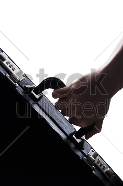 hand carrying a briefcase stock photo