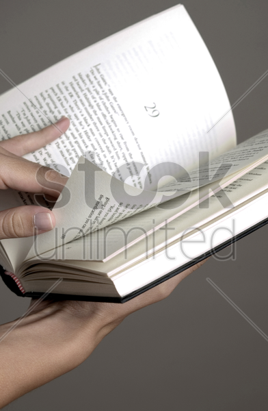 hand flipping book stock photo