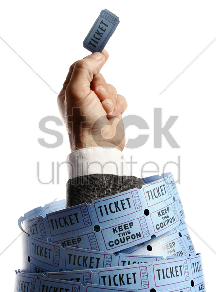 hand holding a ticket stock photo