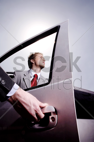 hand opening car door for a businessman stock photo