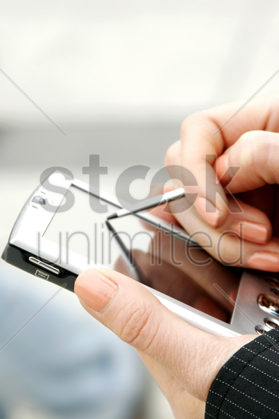 hands using palmtop stock photo