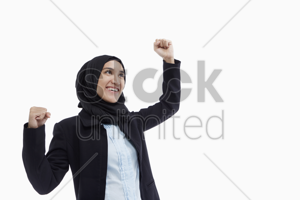 happy businesswoman cheering stock photo