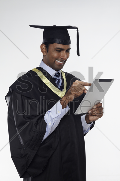 happy man using digital tablet stock photo