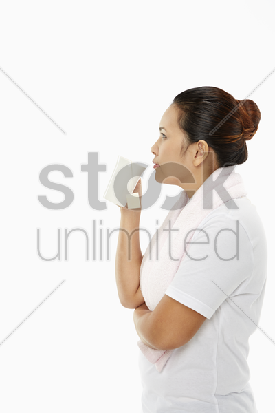 happy woman having a drink stock photo