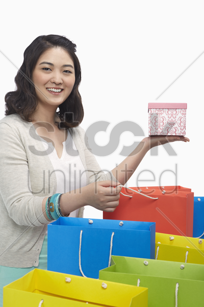 happy woman holding up a gift box stock photo