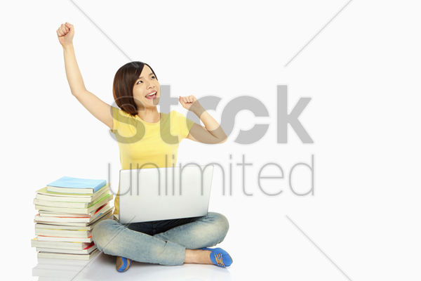 happy woman smiling and cheering stock photo