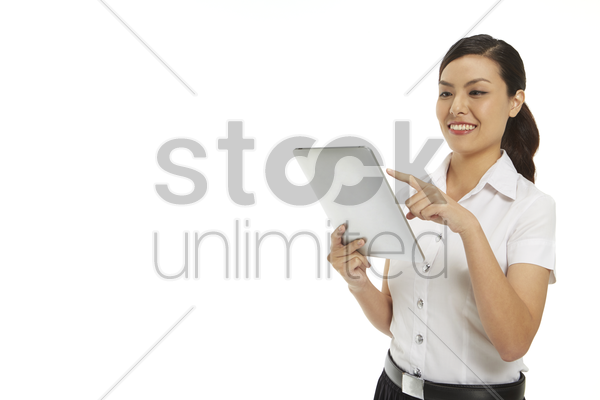 happy woman using a digital tablet stock photo