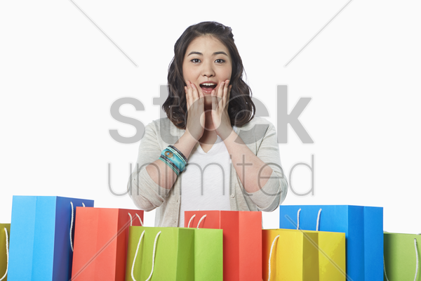 happy woman with a surprised facial expression stock photo