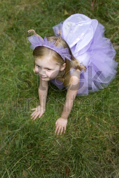 high angle view of little girl wearing ballet dress stock photo