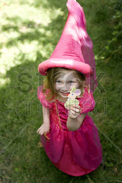 high angle view of little girl wearing princess dress and hennin stock photo