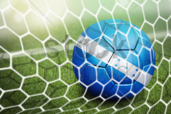 honduras soccer ball in goal net stock photo