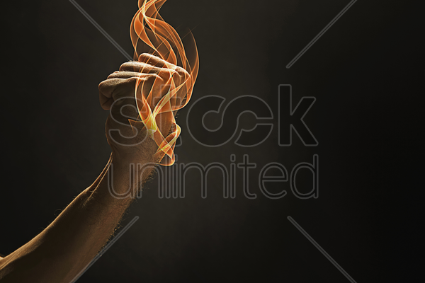 human hand clenching fist stock photo