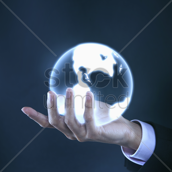 human hand holding a globe stock photo