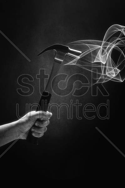 human hand holding a hammer stock photo