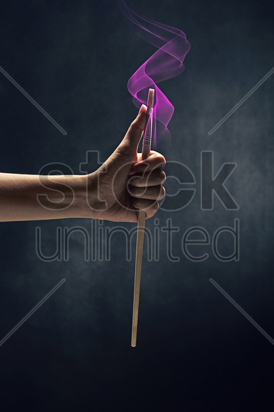 human hand holding a paint brush stock photo
