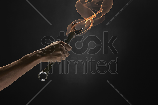 human hand holding a spanner stock photo