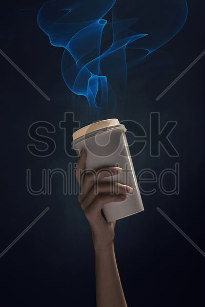 human hand holding up a disposable cup stock photo