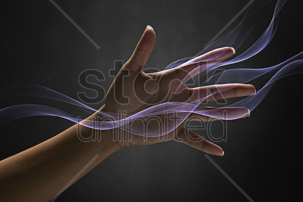 human hand reaching out stock photo