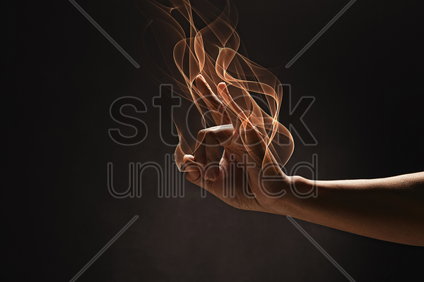 human hand showing a horn sign stock photo