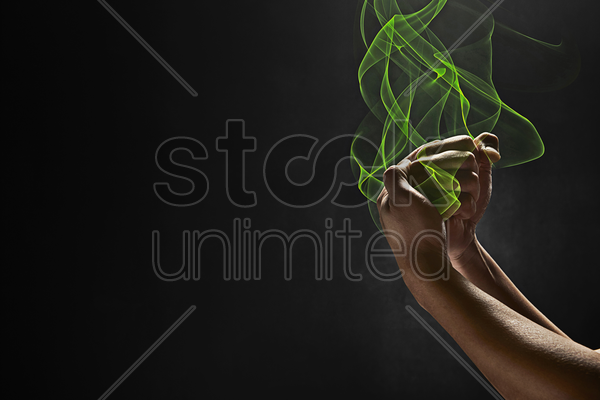 human hand showing a punching gesture stock photo