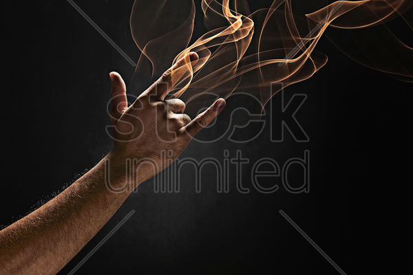 human hand showing horn sign stock photo