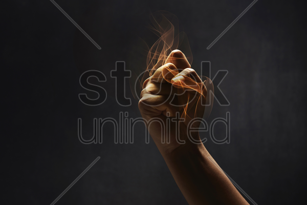 human hand showing punching gesture stock photo