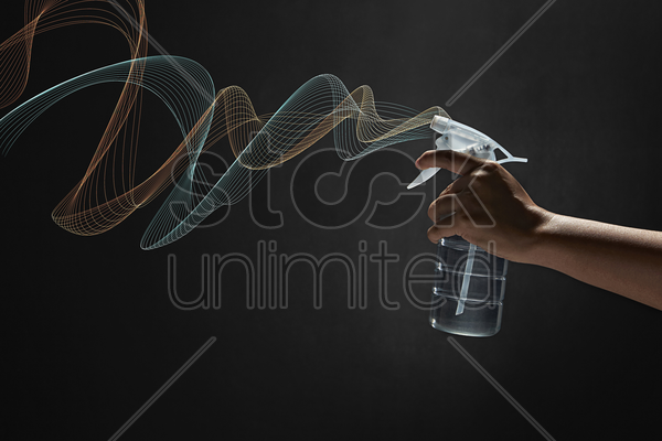 human hand using a spray bottle stock photo