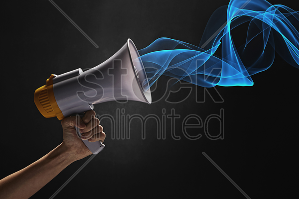 human hand with a megaphone stock photo