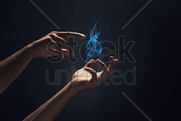 human hands playing with fire stock photo